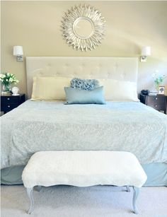 Love the paint color and mirror in this bedroom.