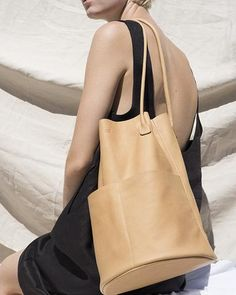 It's actually leather, has great front pockets overall simplicity and wouldn't mind this bag in an array of colors.