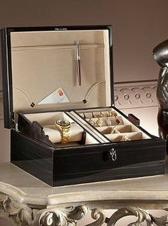 Your husband will love storing his style accessories and valuables in the handsome Agresti Italian Polished Ebony Men's Jewelry Box that offers generous storage and a dark, masculine finish.