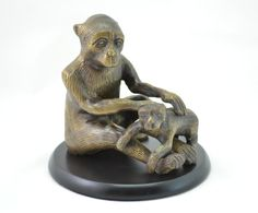 Vintage French Bronze Spelter Statue of Mother and Baby Monkey by vintagecornerbazaar. Explore more products on http://vintagecornerbazaar.etsy.com
