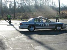 Roanoke Rapids Police Department officers direct traffic on Roanoke Avenue during the Roanoke Canal Half-Marathon/8K.