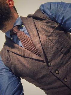 Brown vest and indigo shirt,brown tie...