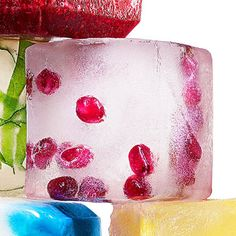 Jewel Tone ~  Add some crunch to your cubes. Fill a tray halfway with water, add a cluster of pomegranate seeds, stir to spread them out, and freeze. Then fill with more water and seeds, stir the new layer and freeze again.