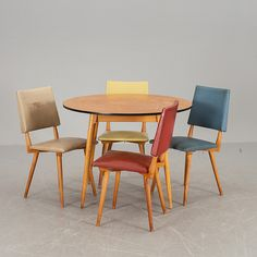 Anonymous; Wood and Leather Side Chairs, c1960.