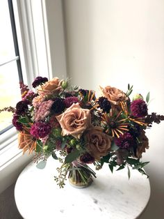 This late August bridal bouquet had a really unqiue color palette of toffee, bronze, chocolate and a touch of dark pink. Flowers included orach, toffee roses, rudbeckia, yarrow, zinnias, chocolate lace, lisianthus and scabiosa. #sahararudbeckia #toffeeroses #bronzeflowers #chocolatelace #summerweddingideas #fallweddingbouquet #fallweddingflowers #weddingcolorschemes #calgaryflowers #bronzebouquet #calgaryweddingflorist #calgary #brownlisianthus #scabiosa #redqueenlimezinnia #zinnia Fall Wedding Bouquets, Fall Wedding Flowers, Bridesmaid Bouquet, Bridal Bouquets, Floral Wedding, Summer Wedding, Flower Girl Bouquet, Bouquet Toss, Red Queen