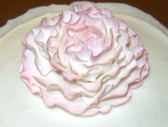 how to make this whimsical peony and there is a link to make a pretty ruffle cake as well