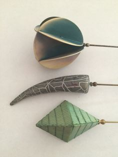 More examples of celluloid hatpins circa-1910s-1920s.