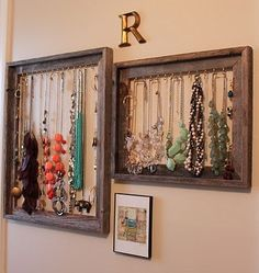 Old picture frames with hooks to hang necklaces, bracelets and on the sides more hooks to place costume rings.