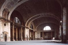Detroit Train Station - the waiting room   Sad majesty. Awesome photography. Click on the picture to take a photo journey through this building, past and present.