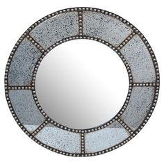Add an artful touch to your entryway or master suite with this round wood wall mirror, showcasing a nailhead-trimmed frame for classic appeal.