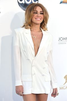 While we weren't too keen on the hair, Miley's white hot suit for worn during the Billboard Award's eclipsed that fact. Miley's been in a steady transformation all year and we love where it's going. Miley's gone from girl next door to girl to the cool chick we all want to besties with.
