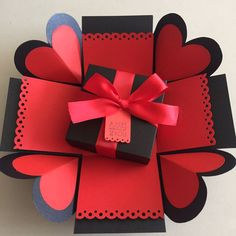 """Buy DIY Explosion Box In Black And Red in Singapore,Singapore. ----------- Info ------------- Size: 4x4""""  Explosion box card with 2 layers, 4 heart flaps ribbon and tag    $6.50 per box   Email mayling77@gmail.com or Whatsa Chat to Buy"""
