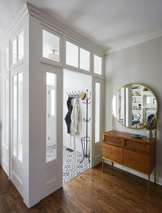 Walton Chicago Residence Hallway Foyer MidCenturyModern Eclectic Transitional by KitchenLab Design Rebekah Zaveloff Interiors Casa Loft, Interior Design Portfolios, Entry Hallway, Hallway Mirror, Foyer Design, Foyer Decorating, House Entrance, Home Remodeling, Living Spaces