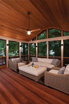 Three season porch with Eze-Breeze® windows and high tongue and groove ceiling. Back porch designed and built by Atlanta Decking & Fence.