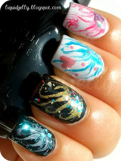 These are really cool!  Though I think it would look better as an accent nail only. All 5 nails is a little busy IMO  -  Liquid Jelly: Needle Marbling Tutorial!