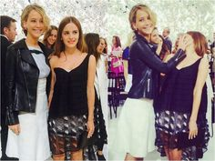 Emma Watson and Jennifer Lawrence apparently having fun at the Dior show.