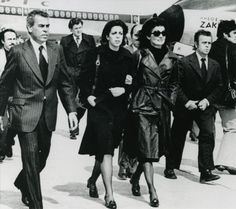 Jacqueline Kennedy Onassis (2nd R) walks with Christina Onassis (C) and followed by Sen. Edward Kennedy as they arrive at Aktion Airport to attend burial services for Aristotle Onassis in Aktion, Greece on June 18, 1975.
