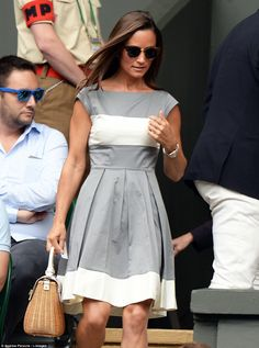Pippa Middleton attended the Wimbledon men's 2014 final wearing a grey and cream dress and holding a wicker handbag