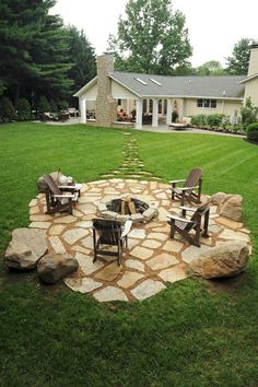 stone walkway from house to island patio within a lovely groomed lawn ... fire pit for cozy outdoor evening