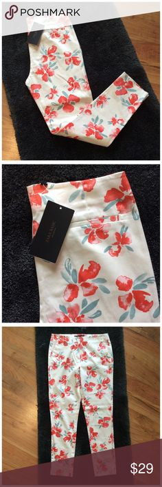 Zara Floral Cigarette Pants Size 2 New with tags.  White, coral, and green colors.  Great for Spring and Summer.  Flat front.  Clasp, button and zipper format entry.  Two front pockets.  Two faux back pockets.  Ankle/Crop cut.  I am a 2 and they fit me. Zara Pants Ankle & Cropped