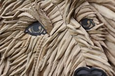 Artist Ali Golzad used nothing but recycled cardboard to create this amazingly expressive portrait of a dog.