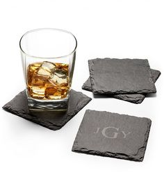 Monogrammed Slate Coasters for Dad  |  Made of solid slate stone, these smooth coasters are perfect for wine glasses, mason jars or any place where special countertops and tables need protection from water rings. Velvet backing prevents any scratches to surfaces, while complimentary monogramming elevates this gift to even greater prestige, creating a perfect gift for Father's Day.