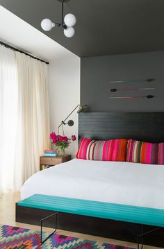 Gray bedroom with pops of color (Source: analogdialog)