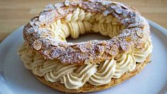 It was 1910 when pastry chef Louis Durand created upon request one of the most famous French desserts of all time, the Paris-Brest. The request came from the organizer of a popular 'Paris-Brest Eclairs, Profiteroles, Creme Dessert, Choux Pastry, Pastry Chef, Pastry Brushes, French Desserts, Sliced Almonds, Meals For One