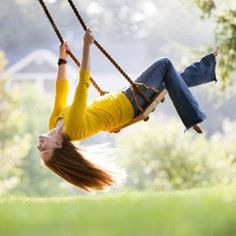 Swinging upside down. We also loved to swing as high as we could and jump from the top! Those were the days!!!