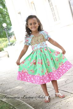 This is so cute. Could do fall colors. Peasant top with a gathered skirt and sash.