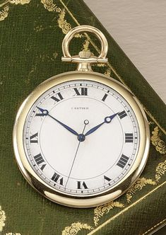 GENTLEMAN'S POCKET WATCH, CARTIER, 1920S. The circular cream coloured dial applied with Roman numerals, dial signed Cartier, movement signed European Watch and Clock Co, Inc, case numbered, French assay marks, fitted case by Cartier Paris.