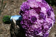 Big purple bouquet! Maybe with a thick white ribbon to wrap the stems and sewn on yellow pearl buttons to accent?