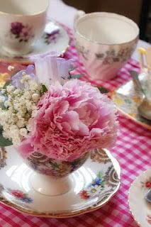 The family made a version of these vintage tea cup centerpieces for my grandmother's 80th Birthday Party!