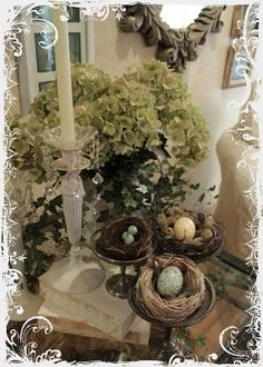 Pretty spring vignette, with nests. Beautiful the best place to find bargin decor goodwill I got an iron tier tray 4 bucks change every season!
