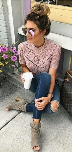 Pretty pink lace blouse with jeans.