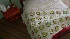 Miniature crochet blanket by Ann Giling.