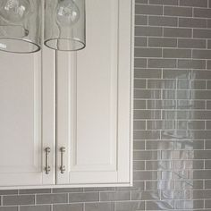 Teaser. Off white IKEA bodbyn. Glass tiles 2x6 in rain from south cypress.com whitekitchen