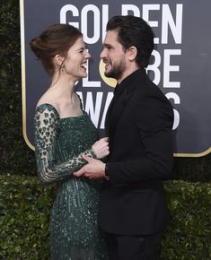Kit Harington revealed he is missing 'his gang' of Game of Thrones co-stars as he arrived on the Golden Globes red carpet on Sunday with his wife Rose Leslie.