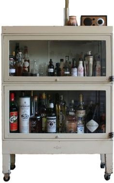 We aren't big drinkers in my household, but it's nice to have a little something around for guests. Which means our liquor cabinet needs aren't much: No glass and mirrored giant in the corner of the living room. That's why I'm taken with these nifty DIY ideas. I'd love to create a small liquor cabinet (that doesn't necessarily look like one) with nothing but elbow grease and little to none of the green stuff.
