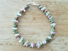 The rose quartz in this one-of-a-kind bracelet brightens up the earthiness of the unakite.