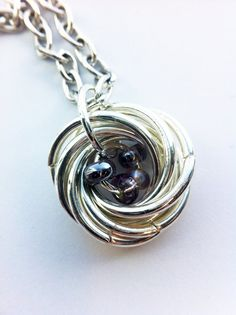 Customizable  Bird Nest Pendant  Silver Mobius with by PetuniaJune, $10.00 I like the design this way, too, swooping the wire around instead of the messy look.