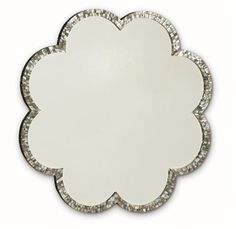 #Caracole: Mood Ring.  Whatever your decorating mood is, this mirror will adapt! A unique black mother-of-pearl surrounds the scalloped mirror frame that houses a clear mirror to add even more sparkle.
