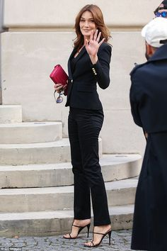 Carla Bruni-Sarkozy, 48, displayed her trim figure and pert derriere as she joined A-listers at the star-studded Balmain show at Paris Fashion Week