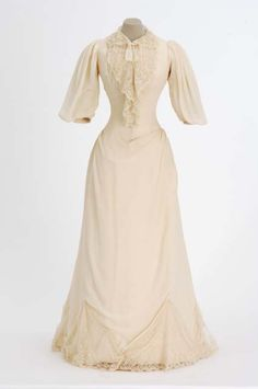 Wedding dress, silk crepe trimmed with lace collar, cuffs and insets in skirt and lined with taffeta, 1892, American. Minnesota Historical Society Collections accession no. 68.22.1