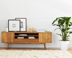 Scandinavian Designs - The Bolig media stand is perfect for incorporating storage capability into your space without adding visual weight. The airy, open design is Scandinavian style at its best, with angled legs and clean lines. Made from wood, it provides three open shelves and a small drawer.:
