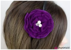 Two pearly white beads and one brilliant rhinestone are nestled in the center of countless purple petals.  Sold as one individual headband.
