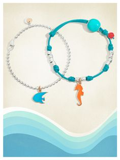 Compose your Dodo bracelet with the colorful angelfish and seahorse charms in 9kt rose gold with turquoise and orange enamel.