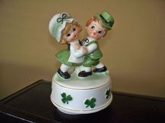 """This is an adorable Price Imports/Japan Irish Lad and Lassie. """"When Irish Eyes Are Smiling"""". It measures 6 1/2"""" tall and rotates while playing. 