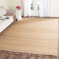 Think coastal living and casual beach house style with rugs so classic they'll even work in the city. Safavieh's natural fiber rugs are soft underfoot, textural, natural in color and woven of sustainably-harvested sisal and sea grass, or biodegradable jut