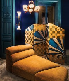 <strong>GOLDEN HOUR</strong> | Italian firm Dimore Studio created the design, which includes this custom screen and daybed upholstered in shaved mink in the fitting room.
